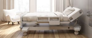 photo of an empty nursing home bed