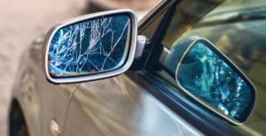 picture of a car's broken side mirror to represent the idea of a car accident scene
