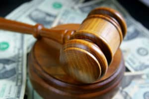 photo of a courtroom gavel and cash