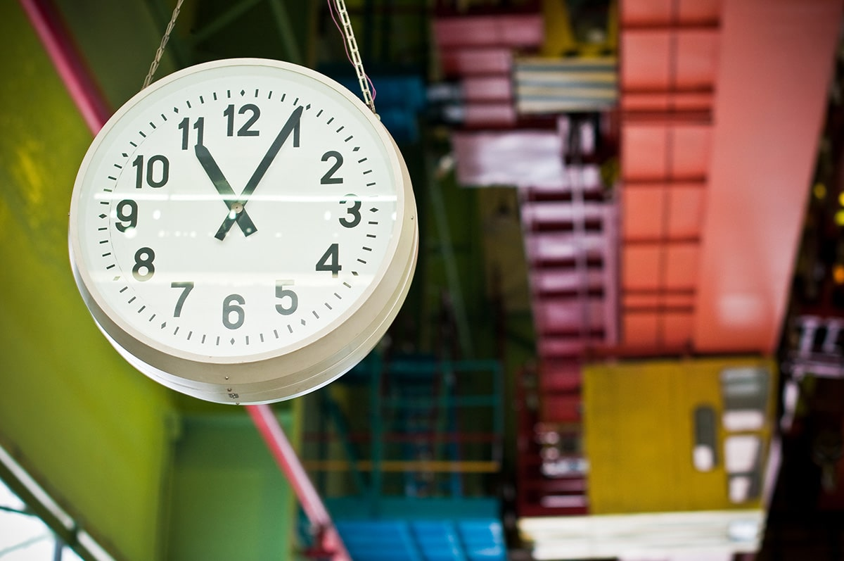 photo of a time clock on a factory floor